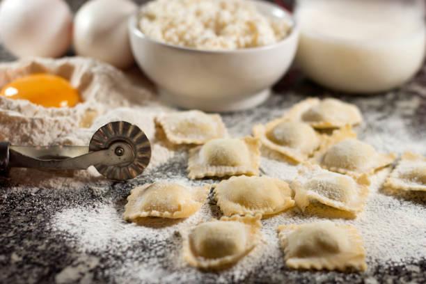 Italian food home made pasta ravioli on granite background stock photo