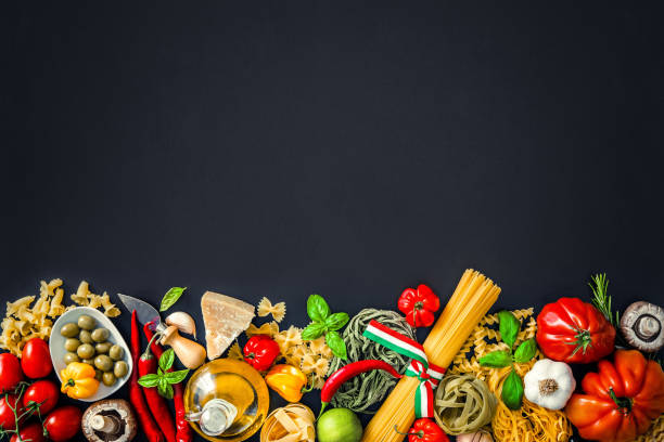 italian food ingredients on slate background - italian food stock photos and pictures