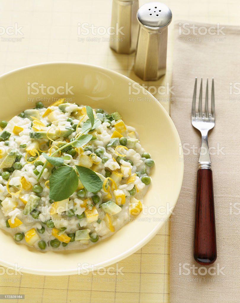 Italian food. Risotto with peas,squash and avocado. royalty-free stock photo