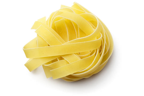 Italian Food: Tagliatelle Isolated on White Background Italian Food: Tagliatelle Isolated on White Background uncooked pasta stock pictures, royalty-free photos & images
