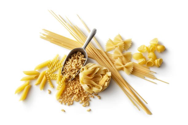 Italian Food: Variety of Pasta Isolated on White Background Italian Food: Variety of Pasta Isolated on White Background uncooked pasta stock pictures, royalty-free photos & images
