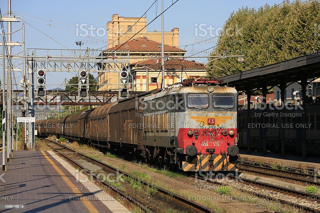 Italian freight train passes through Lucca stock photo