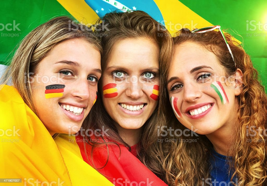Italian, German and Spanish Fans. Brazilian Flag in the Background. stock photo