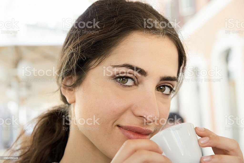 Italian girl drinking coffee royalty-free stock photo