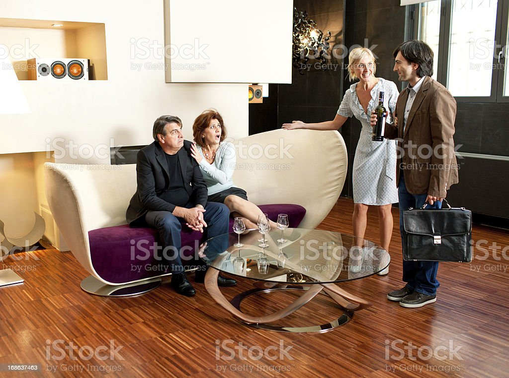 Italian girl introducing her boyfriend to family stock photo
