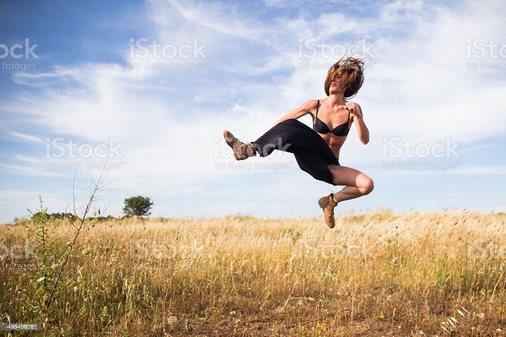 Italian girl is giving a flying kick stock photo
