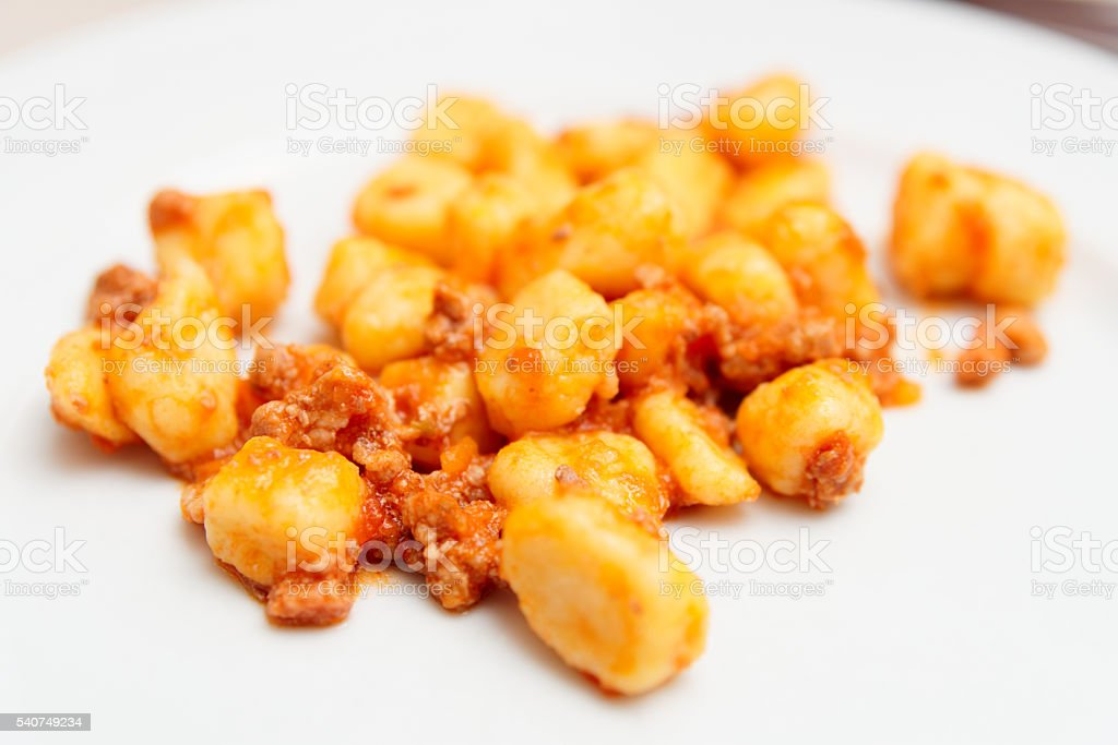 Italian gnocchi with meat ragout stock photo