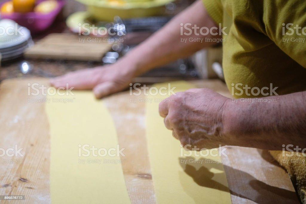 Italian Grandmother preparing homemade Pumpkin Tortelli of Mantua, the traditional receipt of North of Italy stock photo