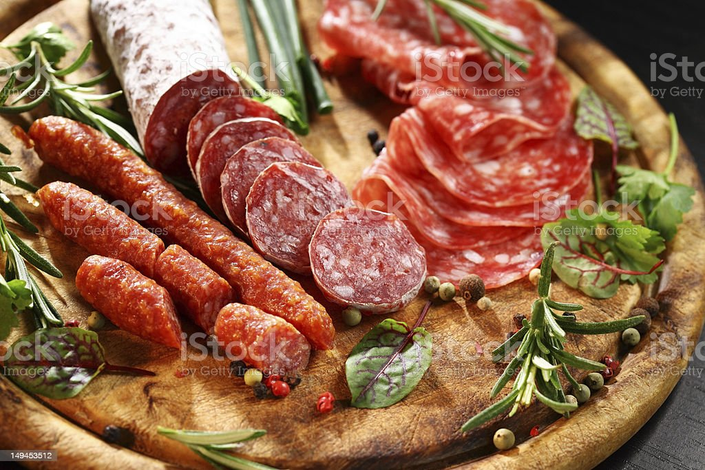 Italian ham and salami with herbs stock photo