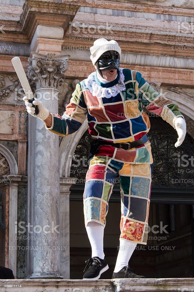 Italian Harlequin at Venice carnival stock photo
