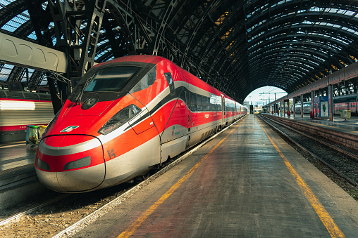 Italian high-speed train Trenitalia Frecciarossa stop at the Central Station of Milan, Italy
