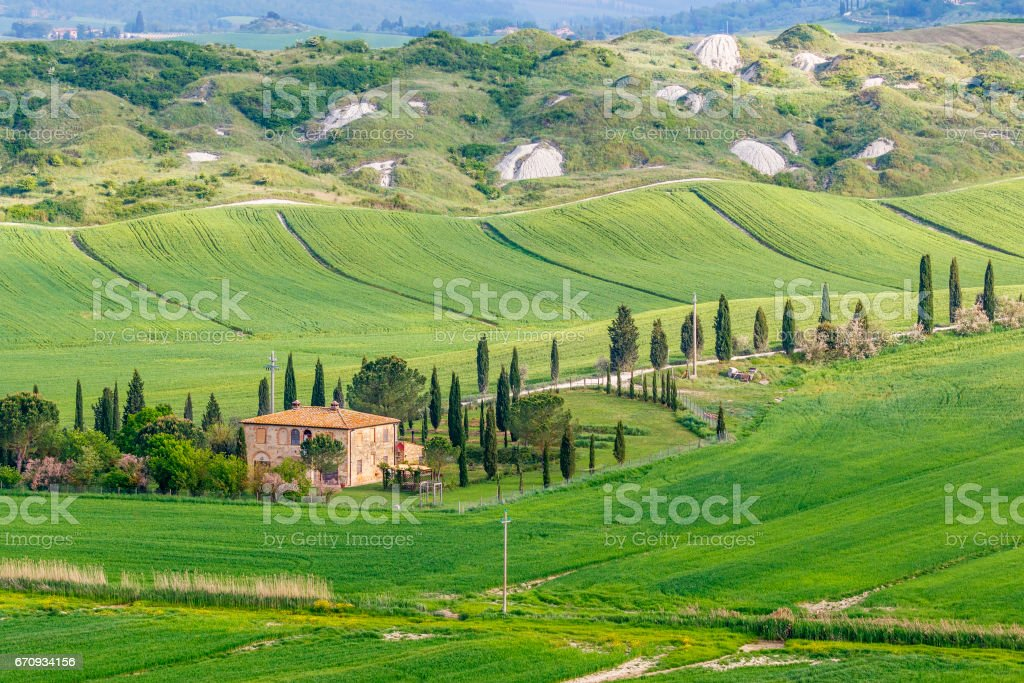 Italian house in country view with fields and hills stock photo