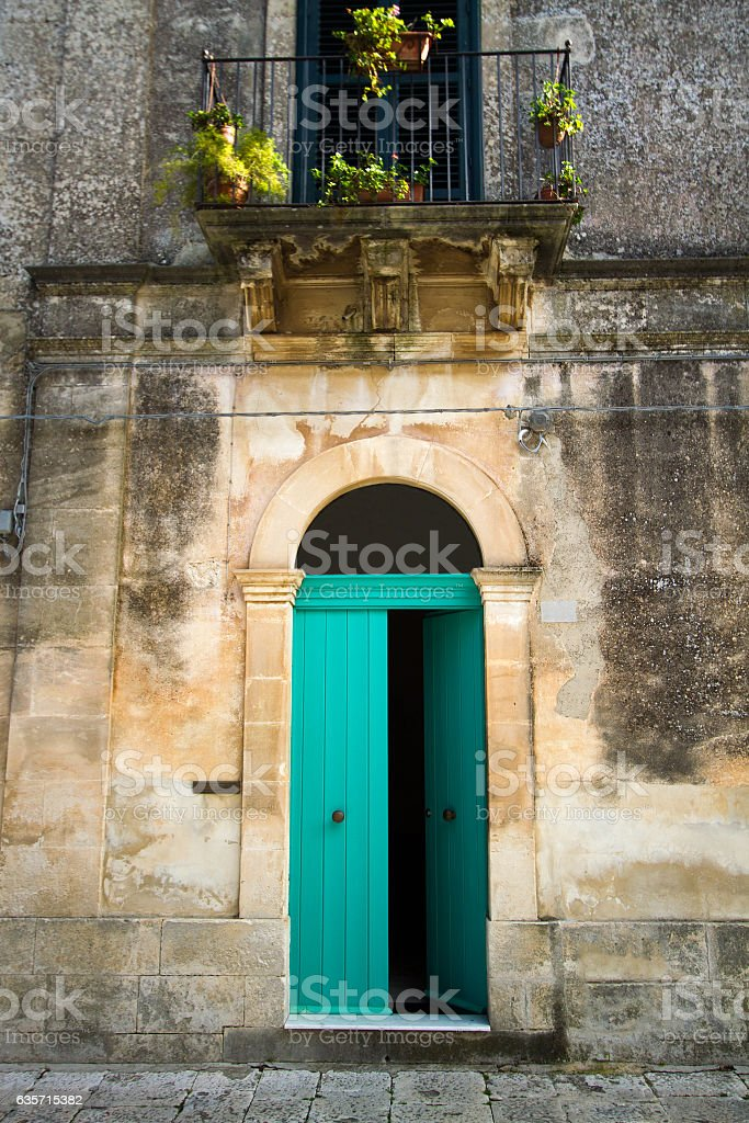 Italian House: Vibrant Arched Green Door and Balcony royalty-free stock photo
