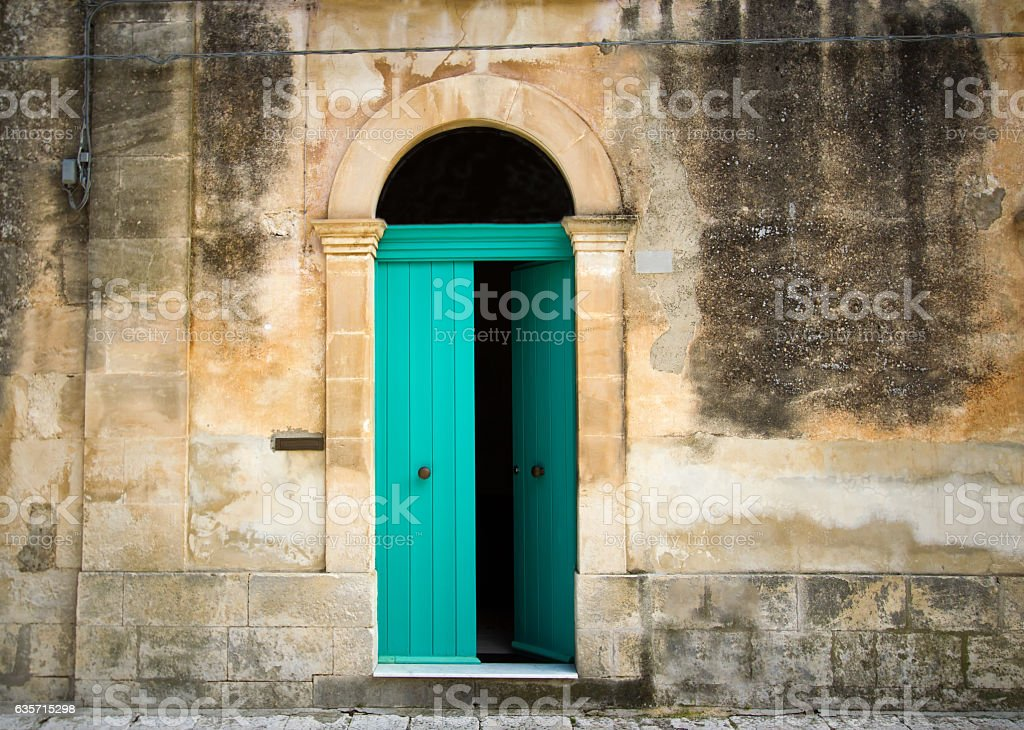 Italian House: Vibrant Arched Green Door in Mottled Wall royalty-free stock photo