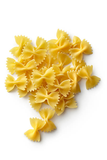 Italian Ingredients: Farfalle Isolated on White Background More Photos like this here... bow tie pasta stock pictures, royalty-free photos & images