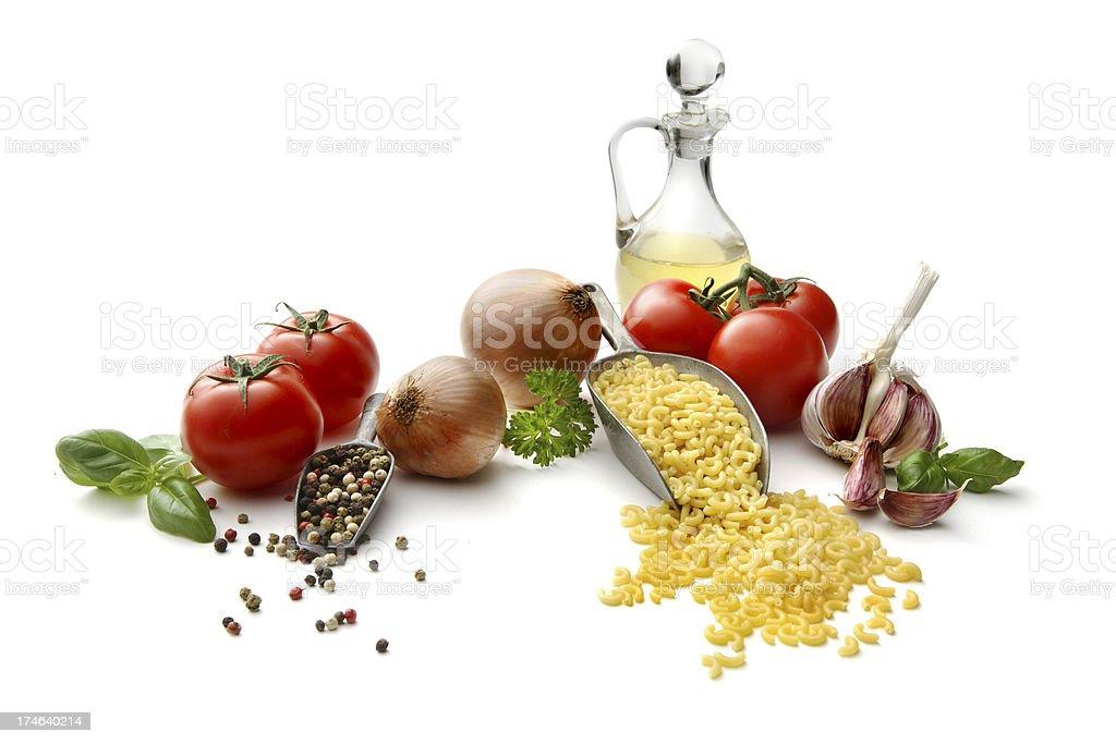 Italian Ingredients: Macaroni, Tomato, Onion, Garlic, Olive Oil and Basil royalty-free stock photo
