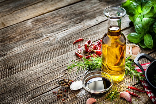 Italian ingredients: olive oil and balsamic vinegar on rustic table