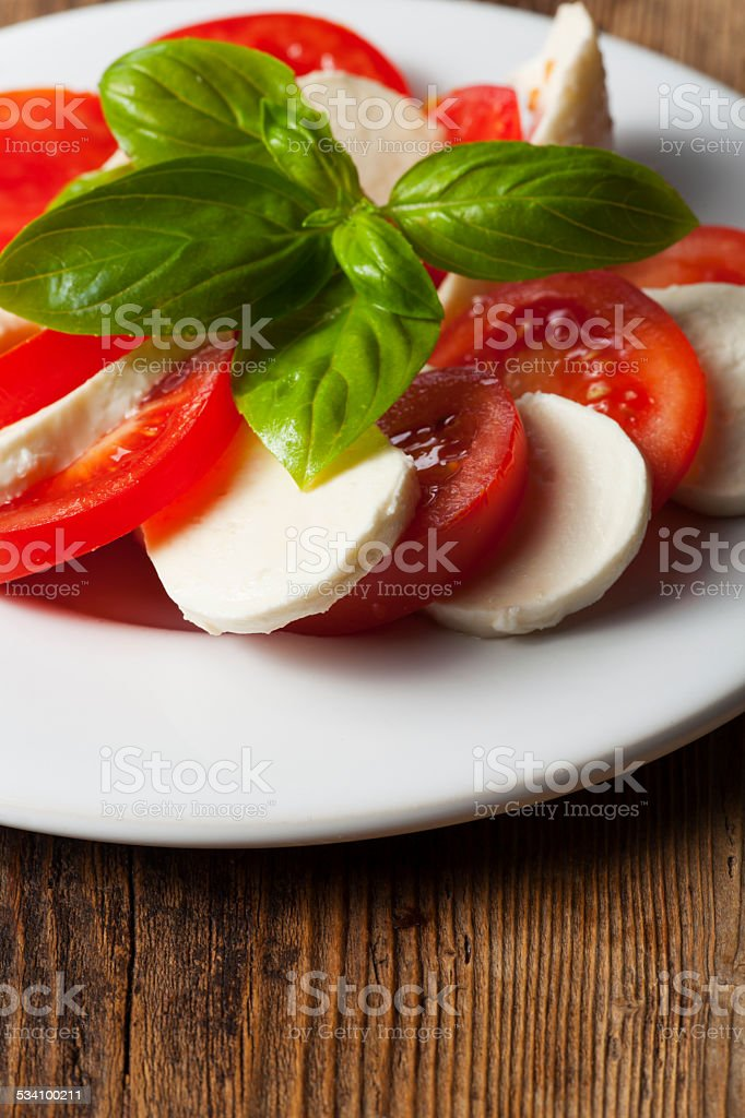 italian insalada caprese on a plate stock photo