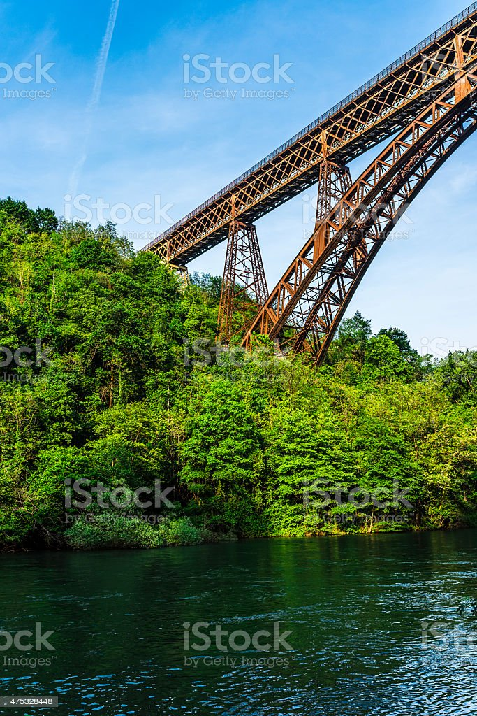 italian iron bridge surrounded by a forest stock photo