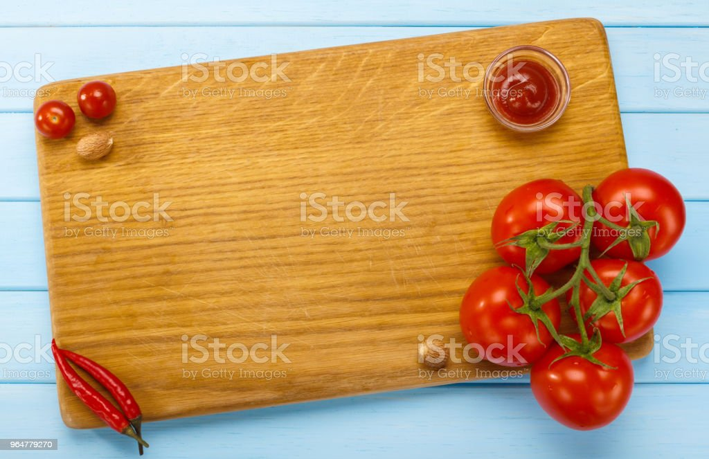Italian kitchen, cutting Board with tomatoes. Place for Your text. Preparation of pasta. Menu title page. royalty-free stock photo