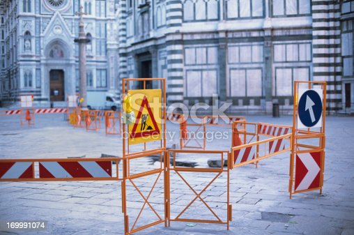March 2013, evening: construction works in Florence. Construction work barriers in Florence - Santa Maria del FioreThe barriers create an interesting contrast with the geometrical motif of the famous Duomo. Shallow depth of focus (50mm f/2), scan from Provia 100F
