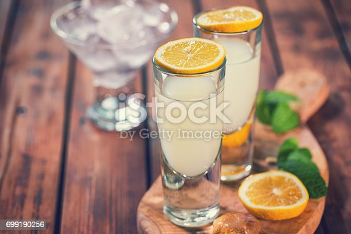 Italian Limoncello , fresh homemade flavorful cocktail combines liqueur,lemon juice,sugar,ice,lemon zest and lemon slices