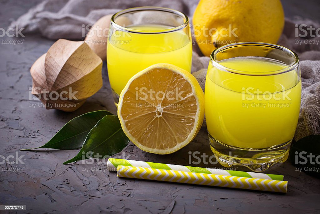 Italian liqueur limoncello with lemons stock photo