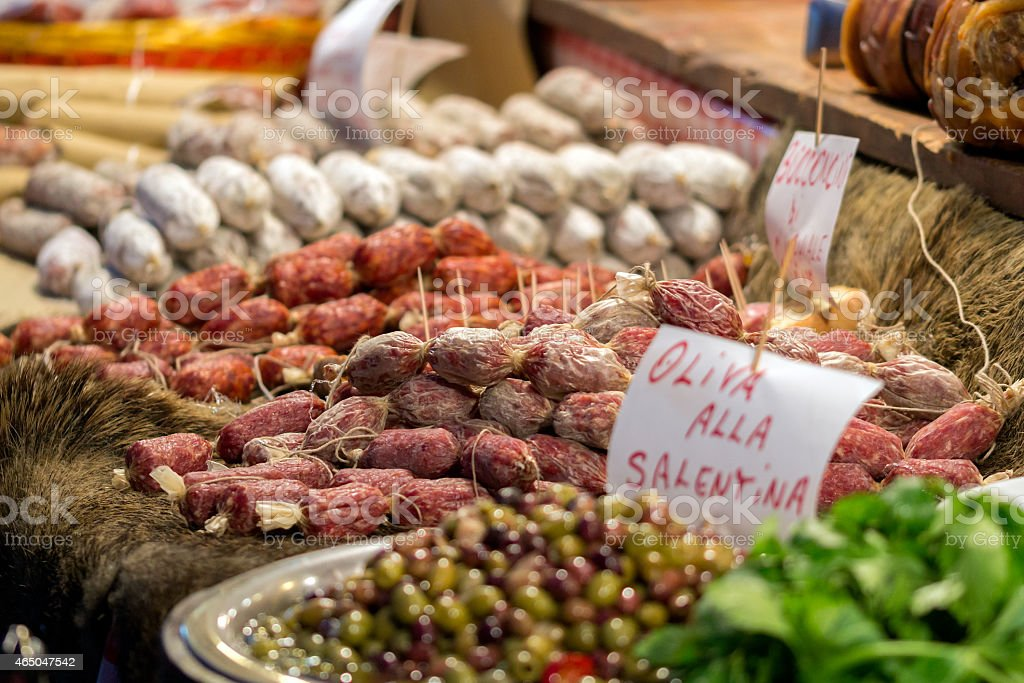 Italian market stall with wild boar salami and olives stock photo