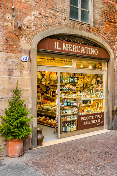 Italian Market Store at Lucca City LUCCA, ITALY, JANUARY - 2018 - Perspective view traditional market store at historic center of lucca, Italy mercato stock pictures, royalty-free photos & images