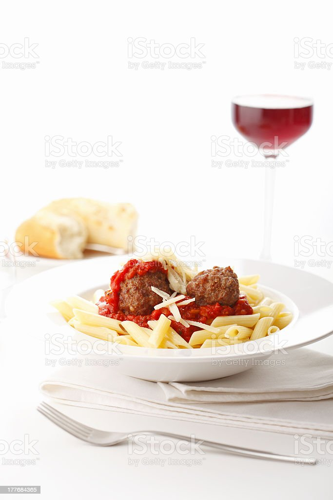 Italian meatballs with penne pasta in tomato sauce royalty-free stock photo