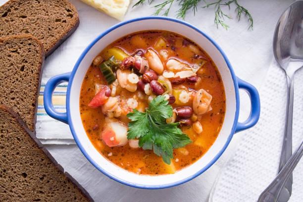 italian minestrone soup in the plate top view - minestrone foto e immagini stock