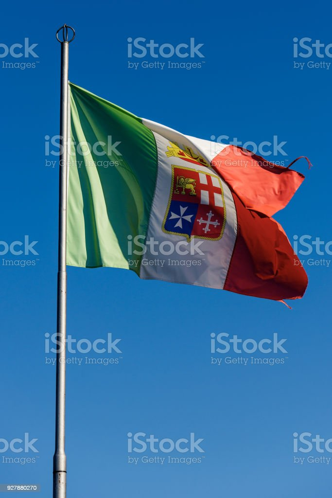 Italian National Nautical Flag on a Clear Blue Sky stock photo