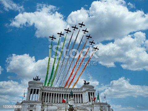 istock Italian National Republic day Air show aerobatic team frecce tricolore flying over altare della patria in Rome, Italy 1220575008