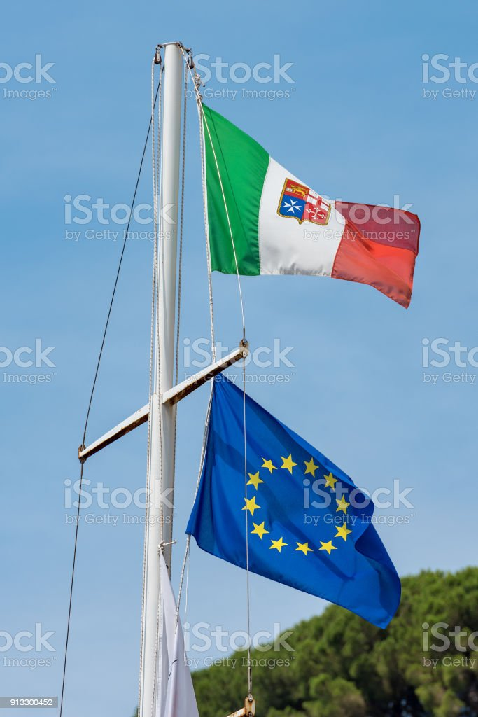Italian Nautical Flag and European on a Ship Mast stock photo