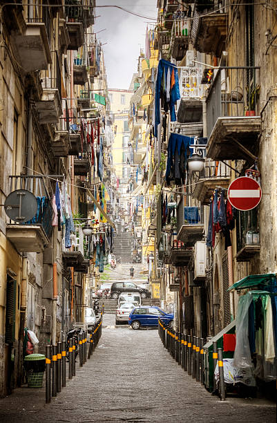 Italian Neighborhood Street scenic from the crowded neighborhoods of Naples' historic Spanish Quarter.    Please see my related collections...  [url=search/lightbox/7431206][img]http://i161.photobucket.com/albums/t218/dave9296/Lightbox_Vetta.jpg[/img][/url]  [url=search/lightbox/4714279][img]http://i161.photobucket.com/albums/t218/dave9296/Lightbox_mediterranean1-V2.jpg[/img][/url]  [url=search/lightbox/4719824][img]http://i161.photobucket.com/albums/t218/dave9296/Lightbox_travelers-V2.jpg[/img][/url] davelongmedia stock pictures, royalty-free photos & images