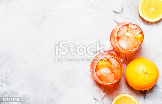 istock Italian Orange Cocktail With Bitter Aperitif, Ice, Sparkling Wine And Orange 878876280