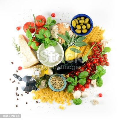 Typical ingredients of the Italian cuisine seen from above on white background. The table fades to white on all four sides. In this shot there is also the coffee maker as coffee and it's flavor are part of life in Italy.