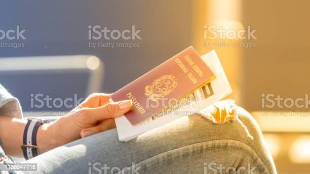 Italian passport and boarding pass in the hands of woman awaiting picture id1136547718?b=1&k=6&m=1136547718&s=612x612&h=f9maguozqkosixwctfr hhjuju hkx6q7t3lljprruk=
