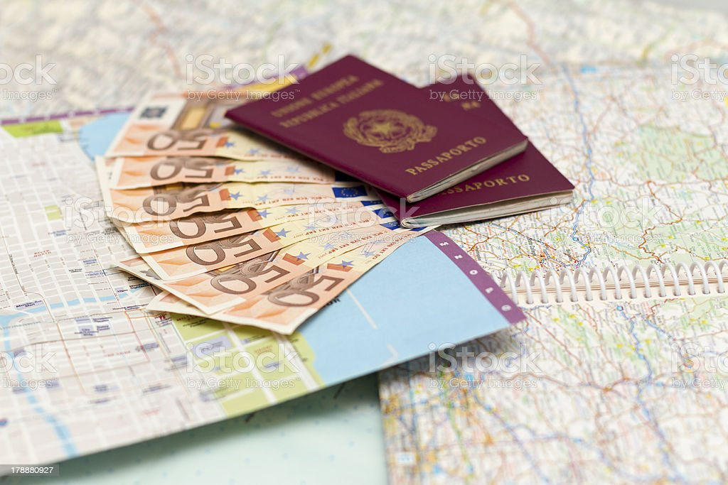 Italian Passport and euro money on map royalty-free stock photo