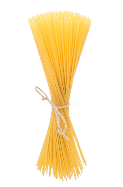 Italian pasta bunch isolated on white background Italian pasta bunch isolated on white background spaghetti straps stock pictures, royalty-free photos & images