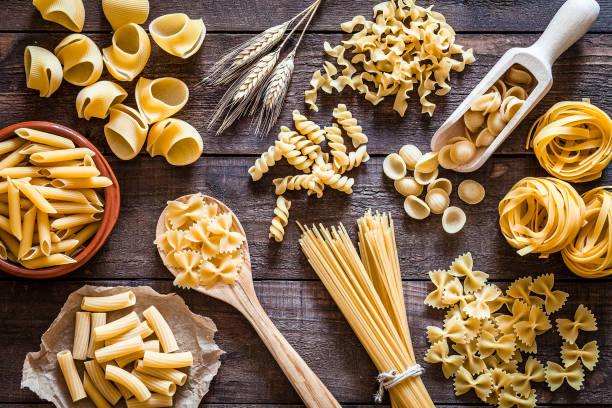 Italian pasta collection on rustic wooden table stock photo