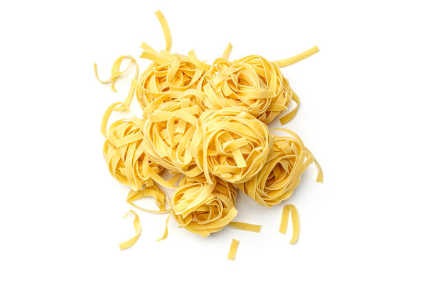 Italian pasta fettuccine nest isolated on white background. Top view stock photo