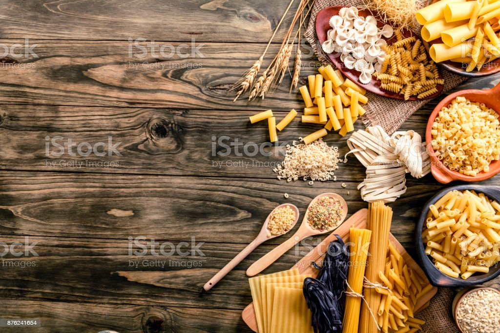 Italian pasta on rustic wooden table in a kitchen stock photo