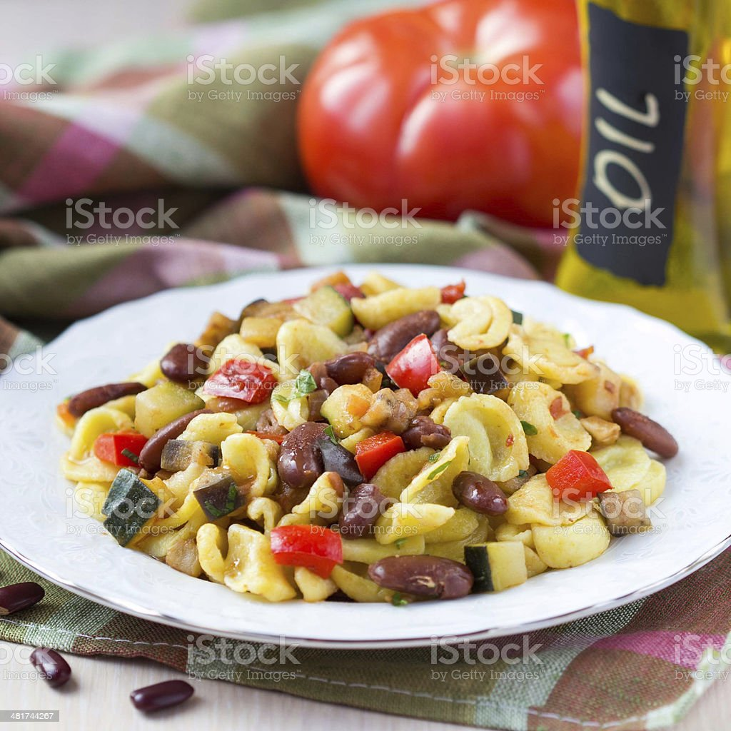 Italian pasta orecchiette with stew of vegetables and bean stock photo