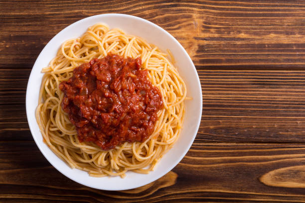 Italian pasta spaghetti Italian pasta spaghetti with tomato sauce and basil spaghetti stock pictures, royalty-free photos & images