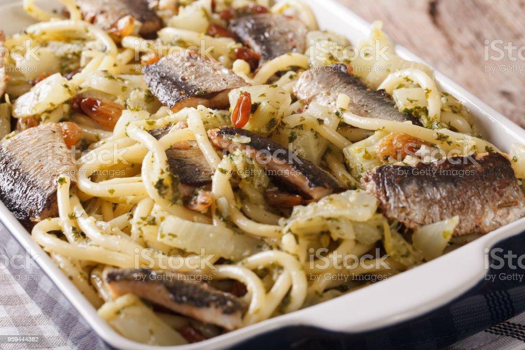 Italian pasta with sardines, fennel, raisins and pine nuts macro. horizontal stock photo