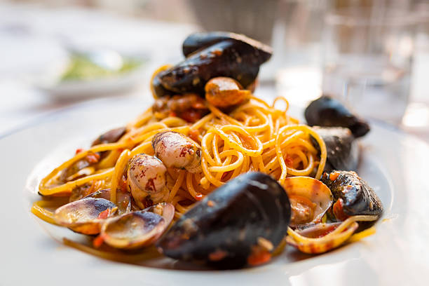 Italian pasta with seafood and herbs Italian pasta with seafood and herbs on the restaurant table mussel stock pictures, royalty-free photos & images