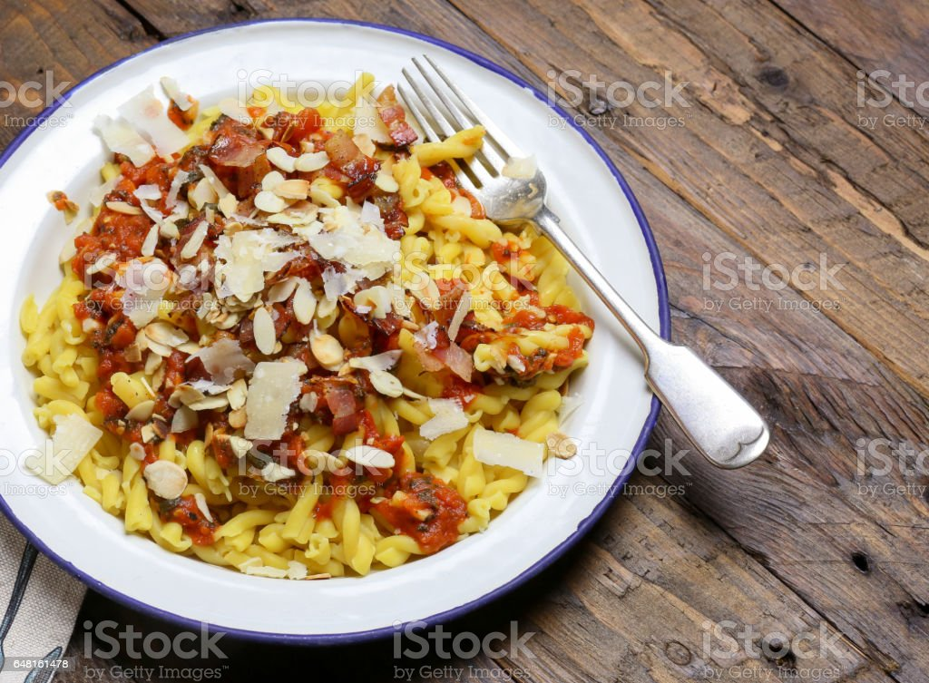 Italian pasta with tomato pancetta almonds and parmesan cheese stock photo