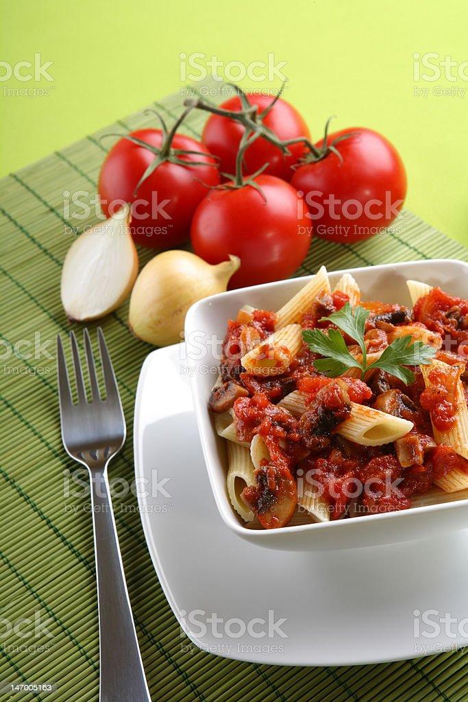 Italian pasta with tomato sause and parmesan. royalty-free stock photo