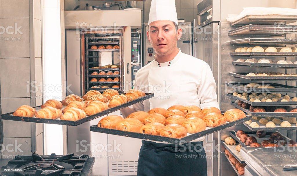 italian pastry chef baking croissants stock photo